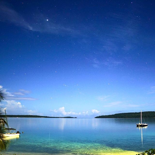 We bought a Sony a6500 just before Christmas and I immediately slapped on a f/1.4 16mm lens to give night photography a shot. Its tough, especially focusing on stars, but when you get a good shot it's all worth it.  This one was taken in Vanuatu at about 10pm at night, it was a full moon but it was very very dark outside. The lens just sucks up light. Zoom in for the stars.