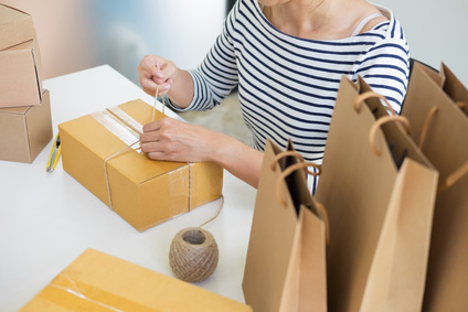 Business owner woman working online shopping prepare product packaging process at her home, young entrepreneur concept.