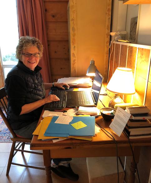 Arleen at the desk in the main floor bedroom.
