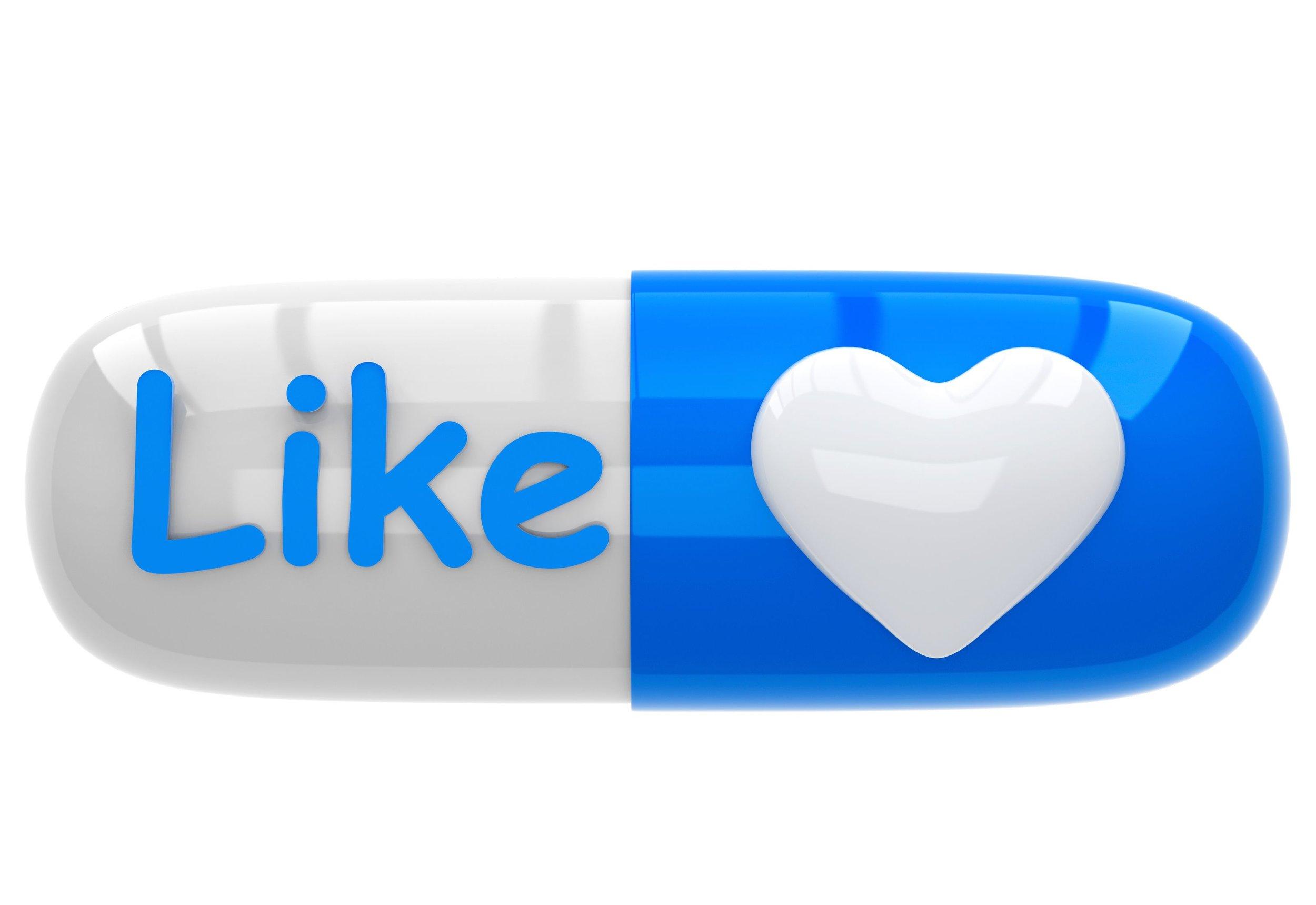 Inscription like and heart on pill capsule HealthCare Medicine Social Media.jpeg
