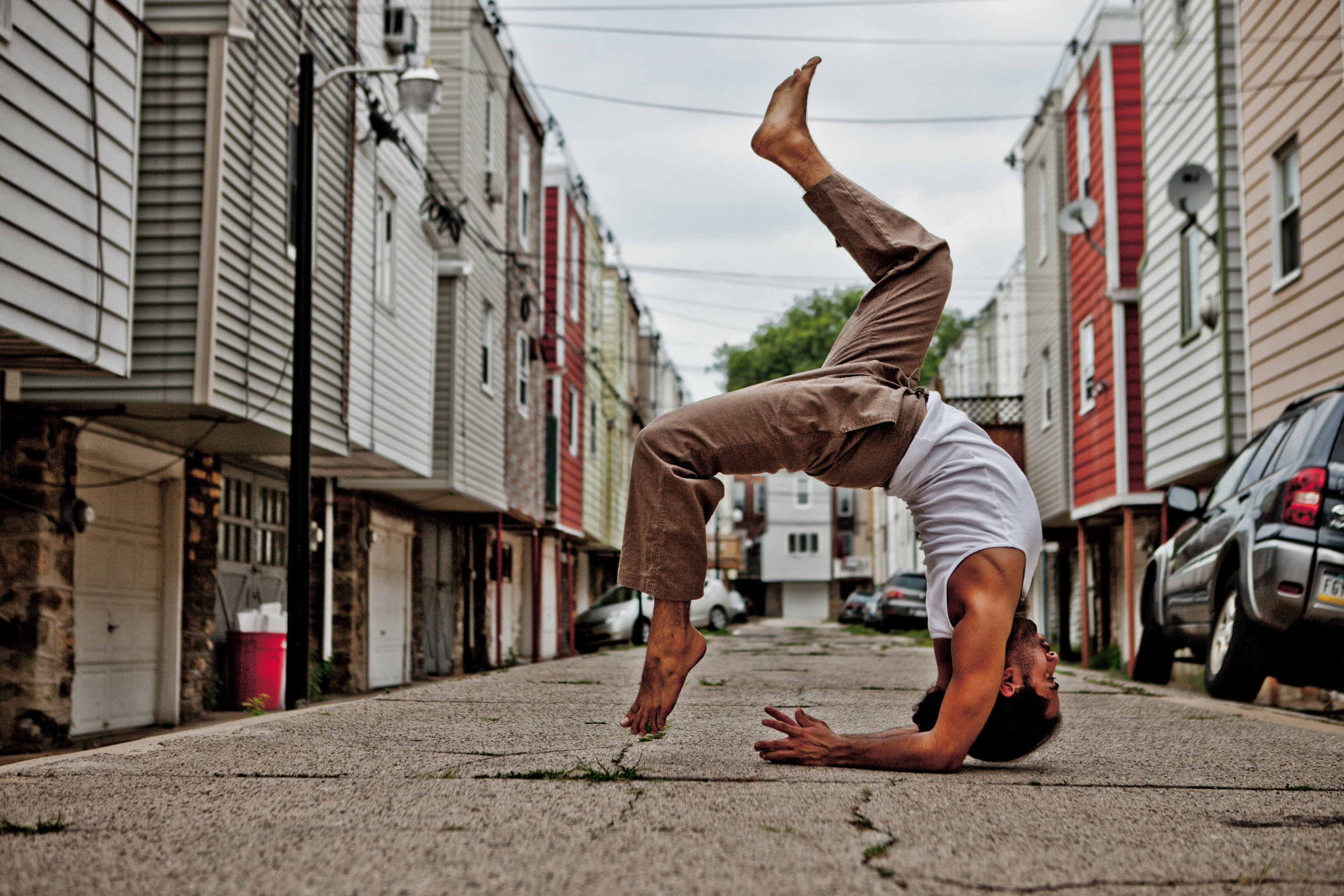 When Noah and I first started creating in 2012 he was a little shy and needed a little coaxing in front of the camera. As you can see from the images the shyness only lasted about 15 minutes. By the end of our first shoot, I was making requests for one-handed handstands and playing in the middle of the road. Needless to say over the years Noah has become an amazing friend and teacher. Enjoy the stroll down memory lane. If you are interested in learning how to grow your yoga and movement practice check out Noah's offerings at  The Yoga and Movement Sanctuary.