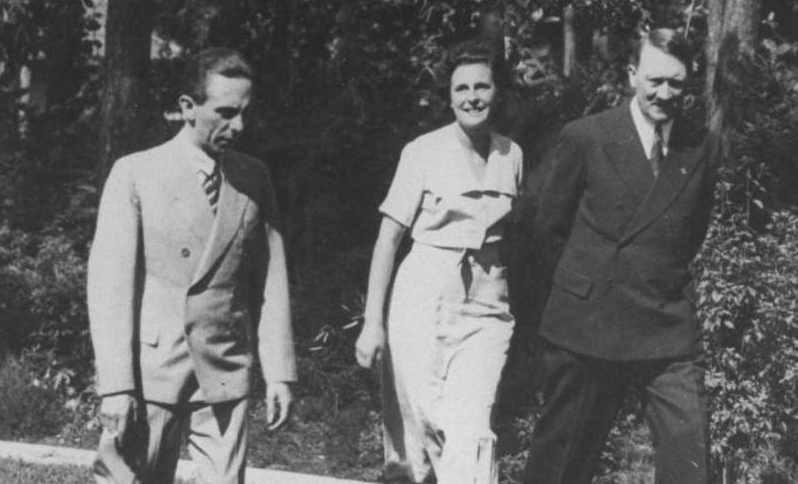 Joseph Goebbels, Leni Riefenstahl, and Adolf Hitler during a tour of her new home.  Photographer: Heinrich Hoffmann