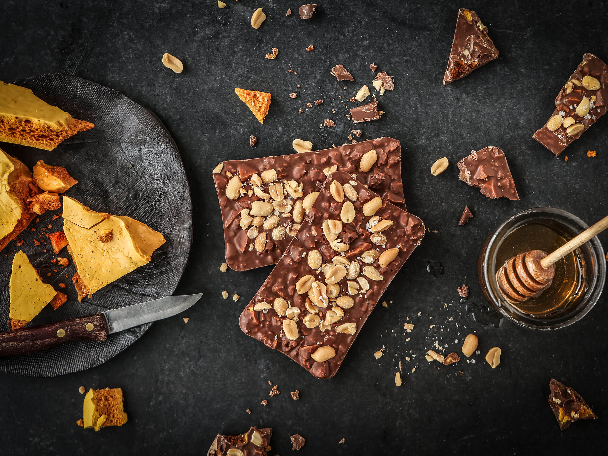 Honeycomb and Roasted Peanut - A long soak and a good read. When is the last time you treated yourself to that incomparable pairing of a bath and a book? It doesn't matter, since it can never be enjoyed often enough. To maximize the moment's indulgence, include Rhoda Cocoa's irresistible Honeycomb and Roasted Peanut chocolate bar, sweet and salty at its best.