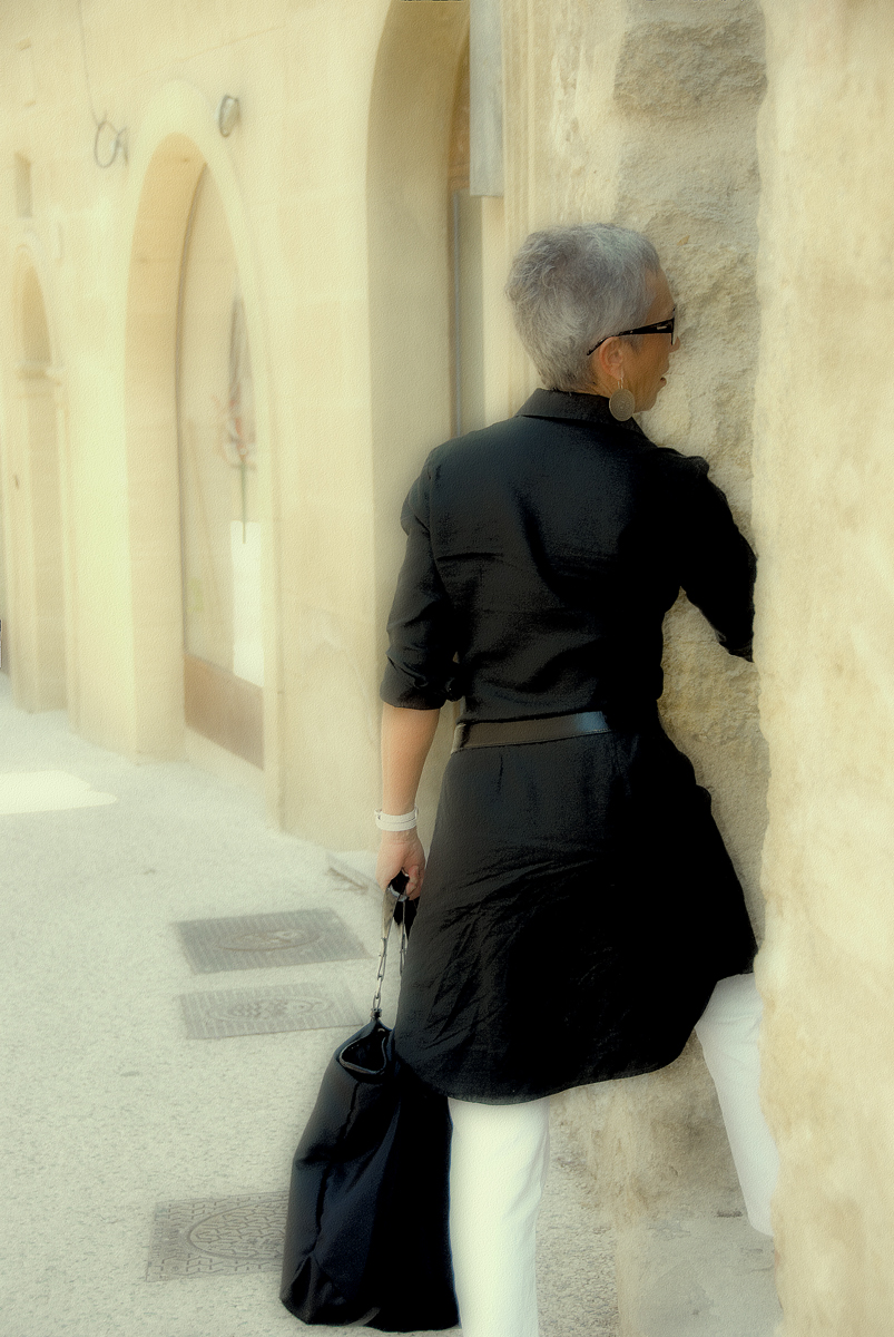 (untitled) Gray haired woman in black leaving home, Lourmarin, France 2008  [I've had numerous people say that she looks a lot like me!]