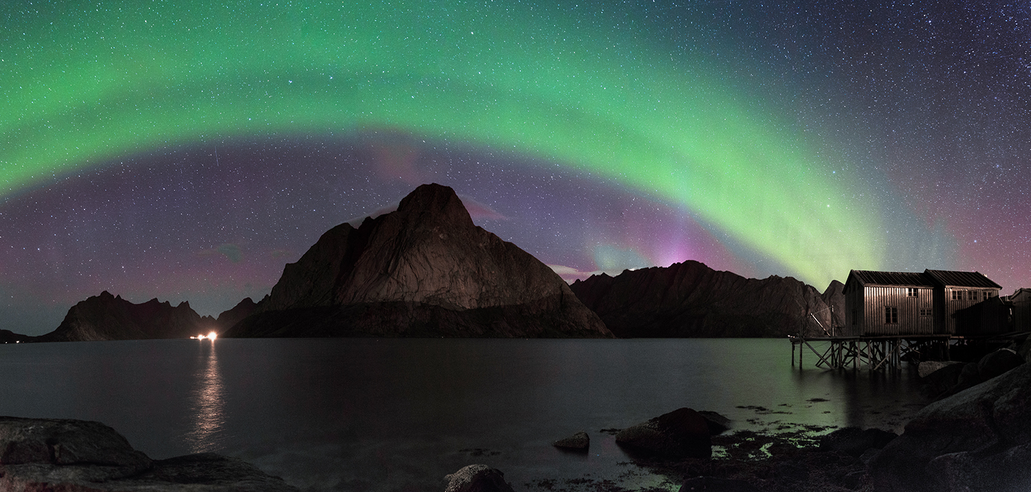 The night I took this photo, the aurora was quite boring. It didn't move but just formed a large band in the sky (and a few flares behind the mountains). A single image of this scene was uninteresting, therefore I decided to shoot a panoramic photo. Five images shot with a Tamron SP 24-70 F/2.8 @ 24 mm | F/2.8 | 20 sec | ISO 2500