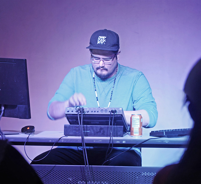 Music & Sound - Exquisite Ghost aka Jordan Thomas from Peguis First Nation is an electronic artist and sonic experimenter who melds urbanity and Indigenous futurisms. Following the release of his album Shrines (2013) on Salient Sounds, he opened for Aboriginal Music Week 2015. He contributed to the Indigenous Futurisms Mixtape (2015) and Leanne Simpson's Under Your Always Light (2016). He debuted on RPM Records with the dual track, single release–The Heart (A Side) and The Heart (B Side) (2017). In Along the River of Spacetime, he balances natural sounds from the rivers with acoustics and electronic beats.
