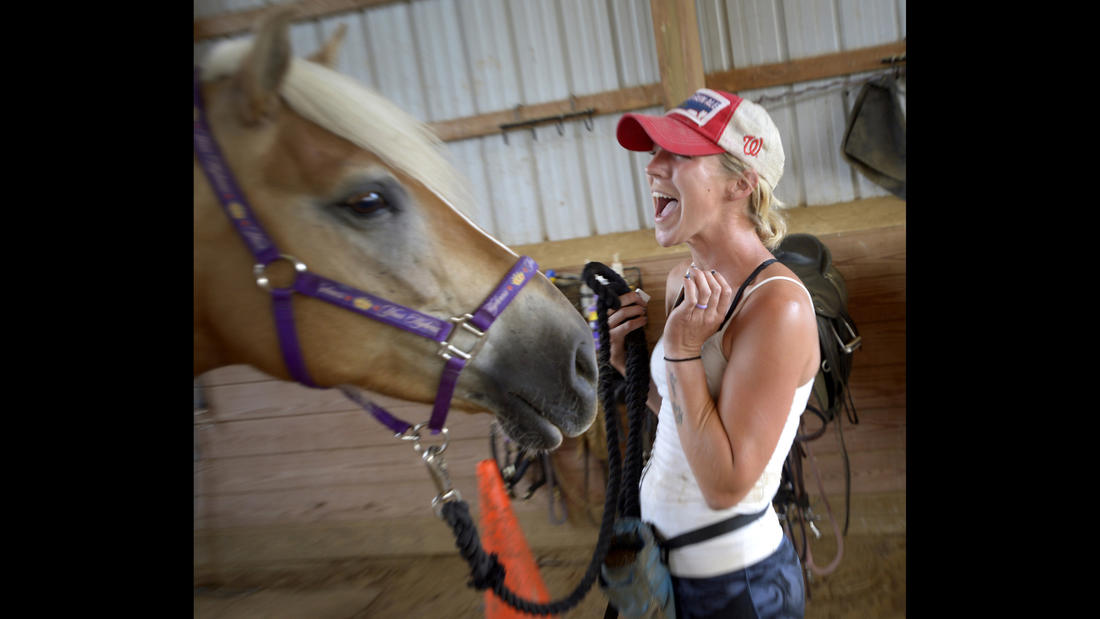 Lauren Bognovitz works with Pandora, female Haflinger, during a training session at Gentle Giants Draft Horse Rescue in Mount Airy Friday, July 13, 2018.