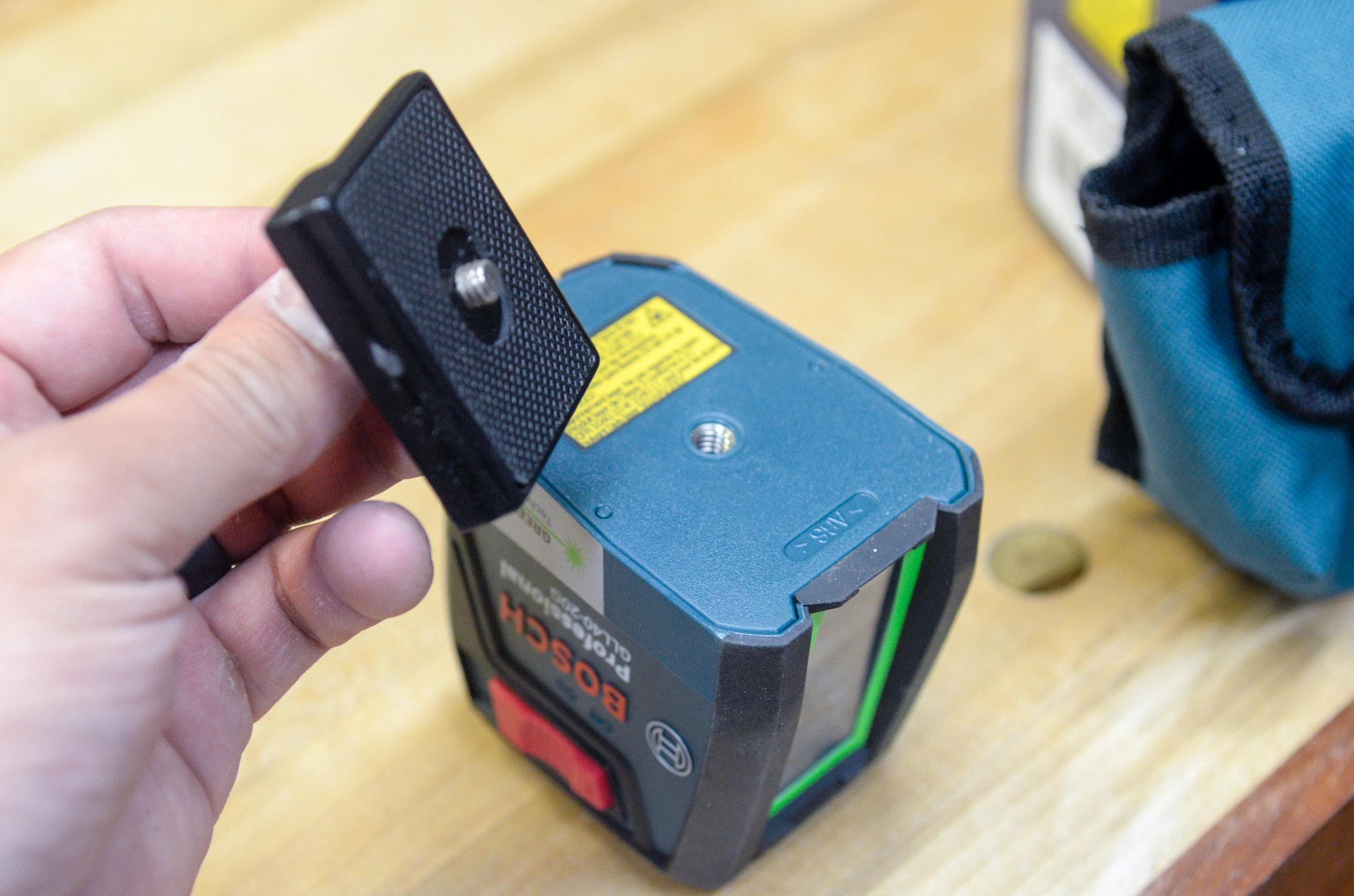 "1/4""-20tpi threads accept a camera tripod bracket."