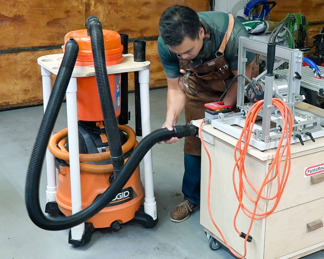 The Ridgid 14 Gal. 6.0-Peak HP NXT Wet Dry Vac being used with the Pantorouter.
