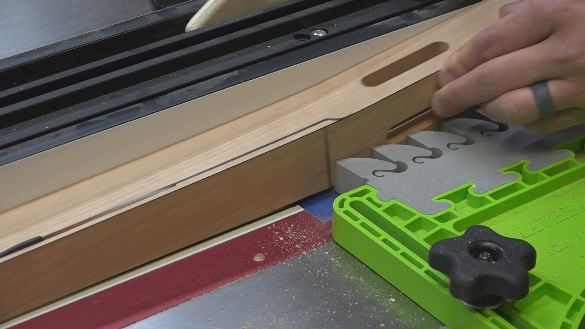 """However, I had to make a """"stopped cut"""" and avoid the blade from cutting into the curved portion of the cloud lift. I did this by placing a piece of blue painters tape just ahead of the front of the table saw blade."""