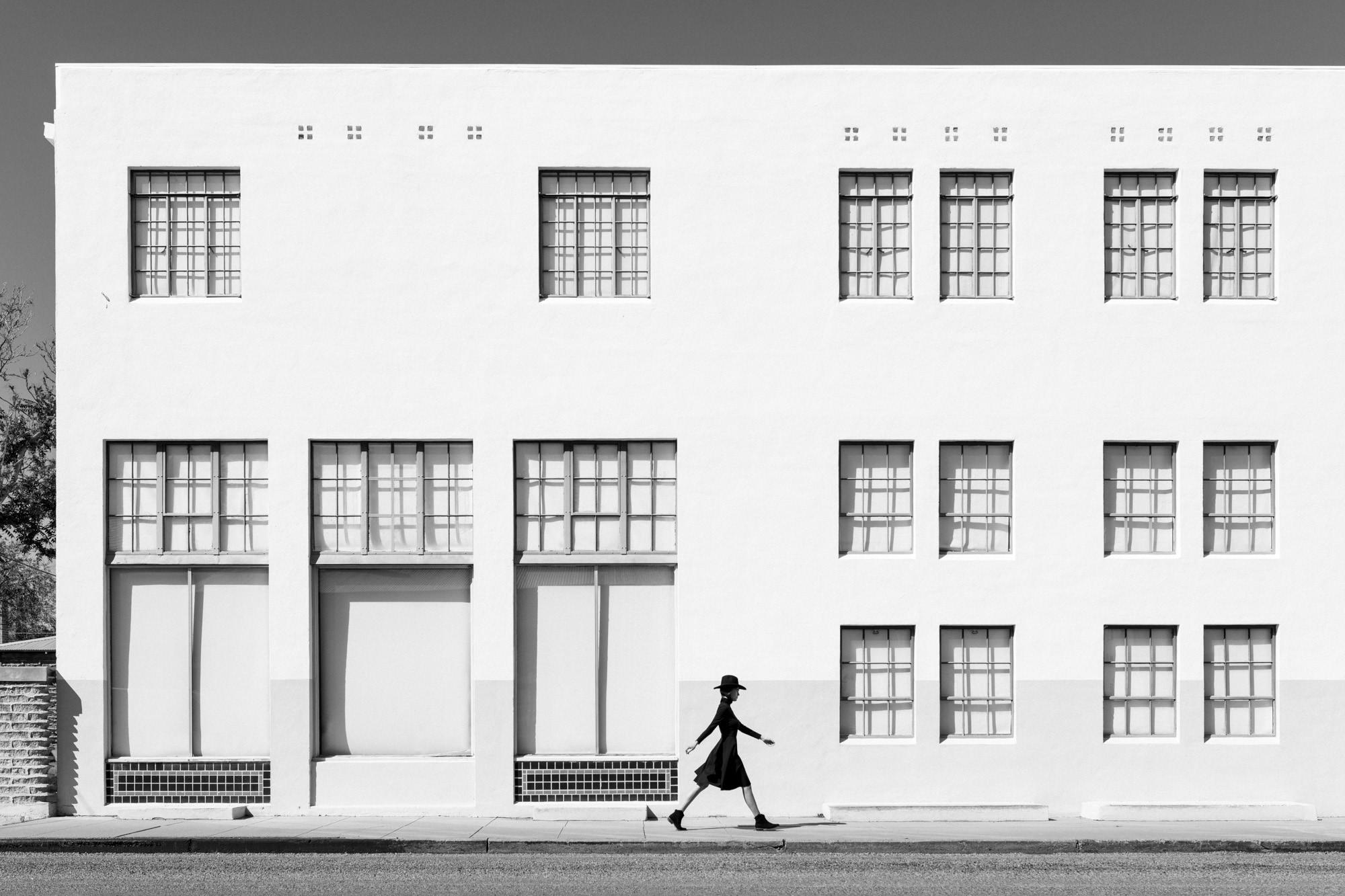 Kate Walking White Building