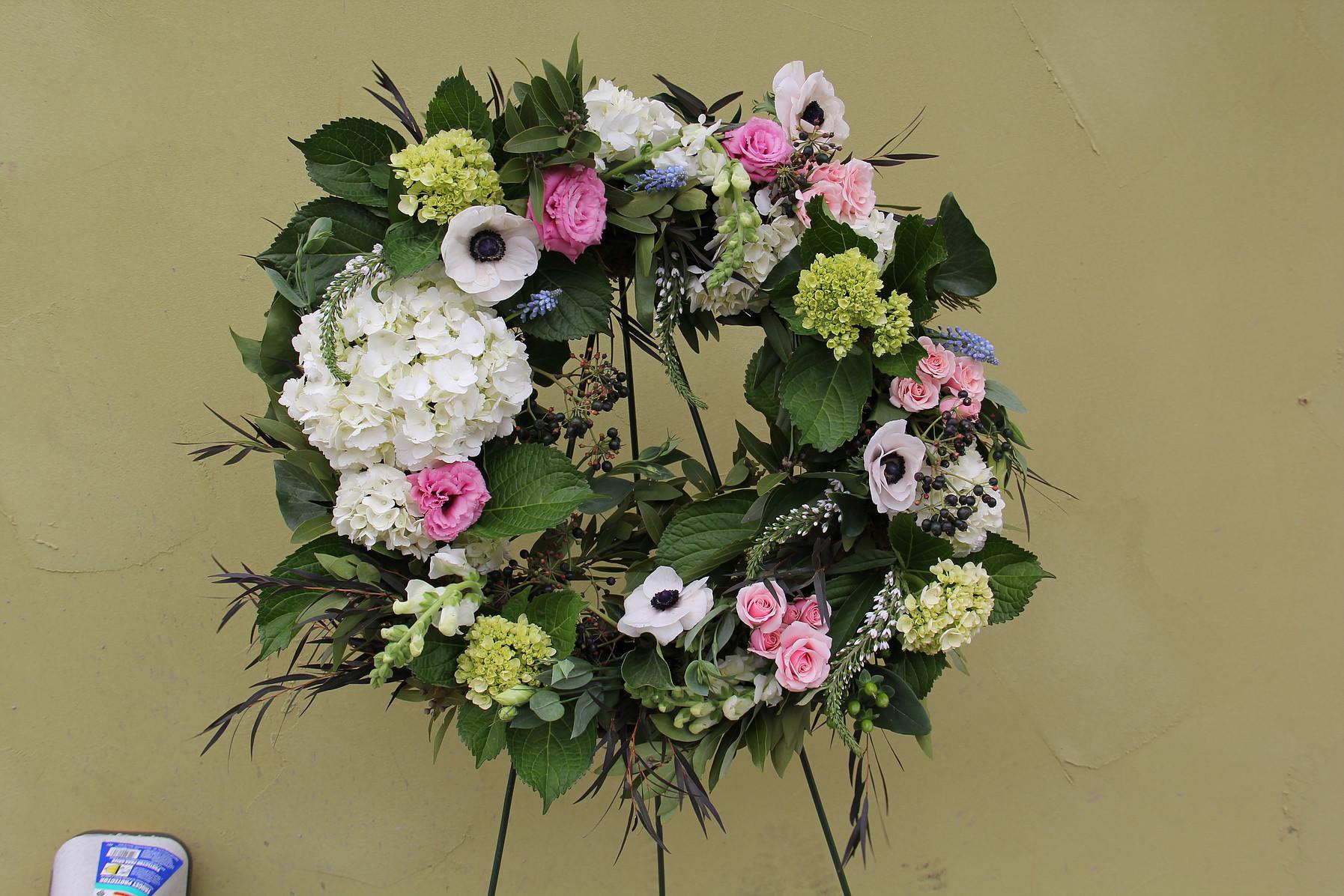 fresh floral wreath on easel.jpg