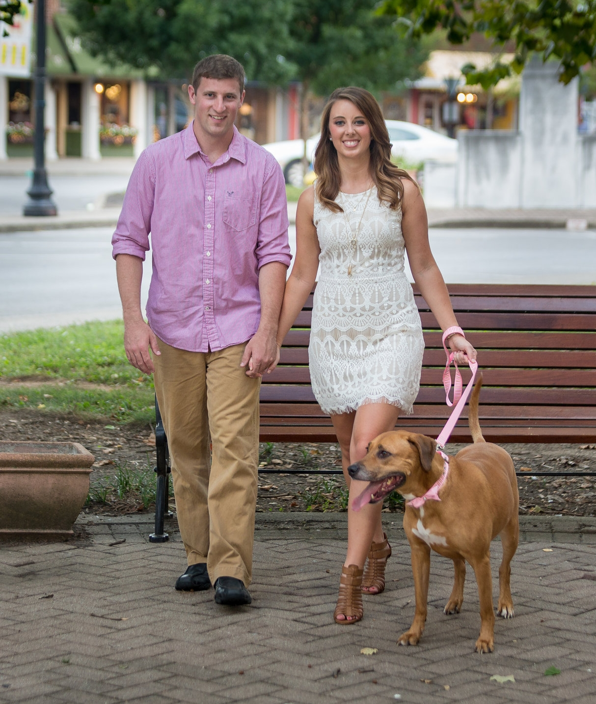 Leigh Achenbach, the owner of Suddenly Simple Professional Organizing and her husband Joey with their dog Nala.