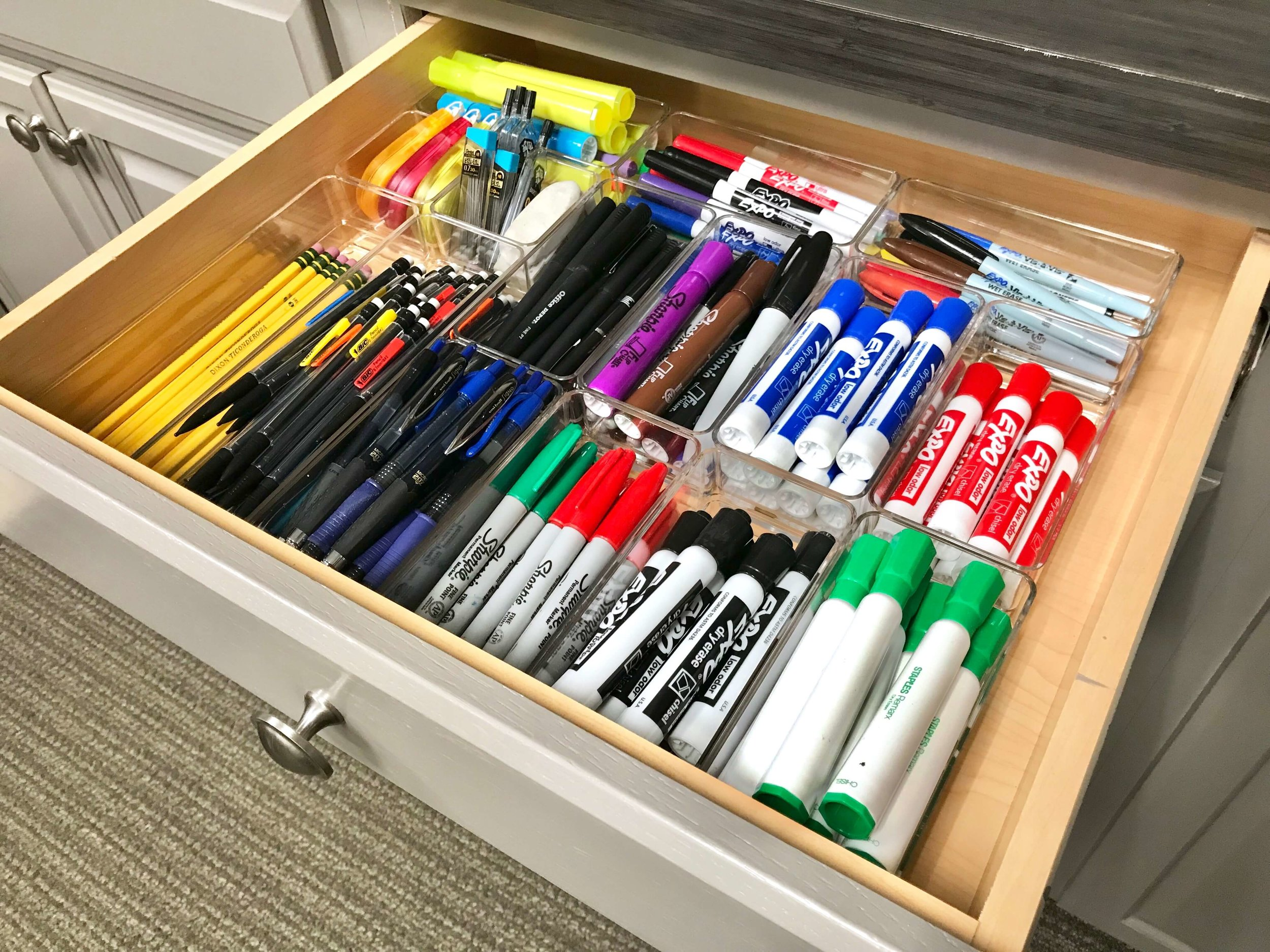 This office supply room was sorted and decluttered to create an organized and clean space.