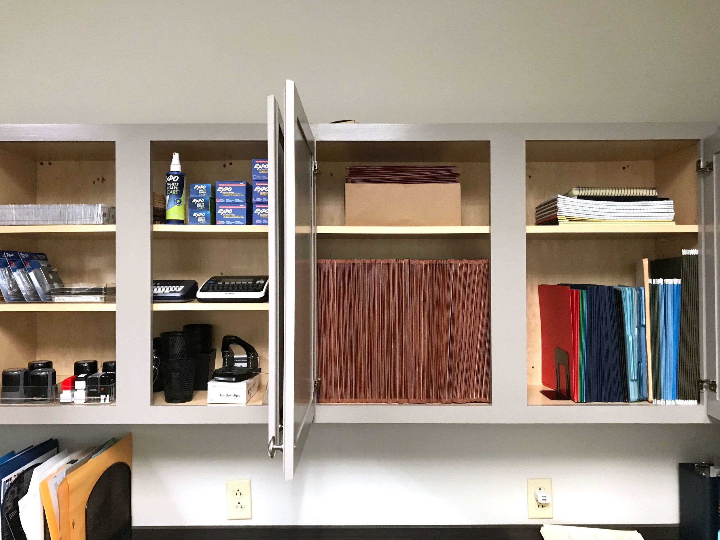 Extra supplies and files are sorted and stored so they are easy to find.