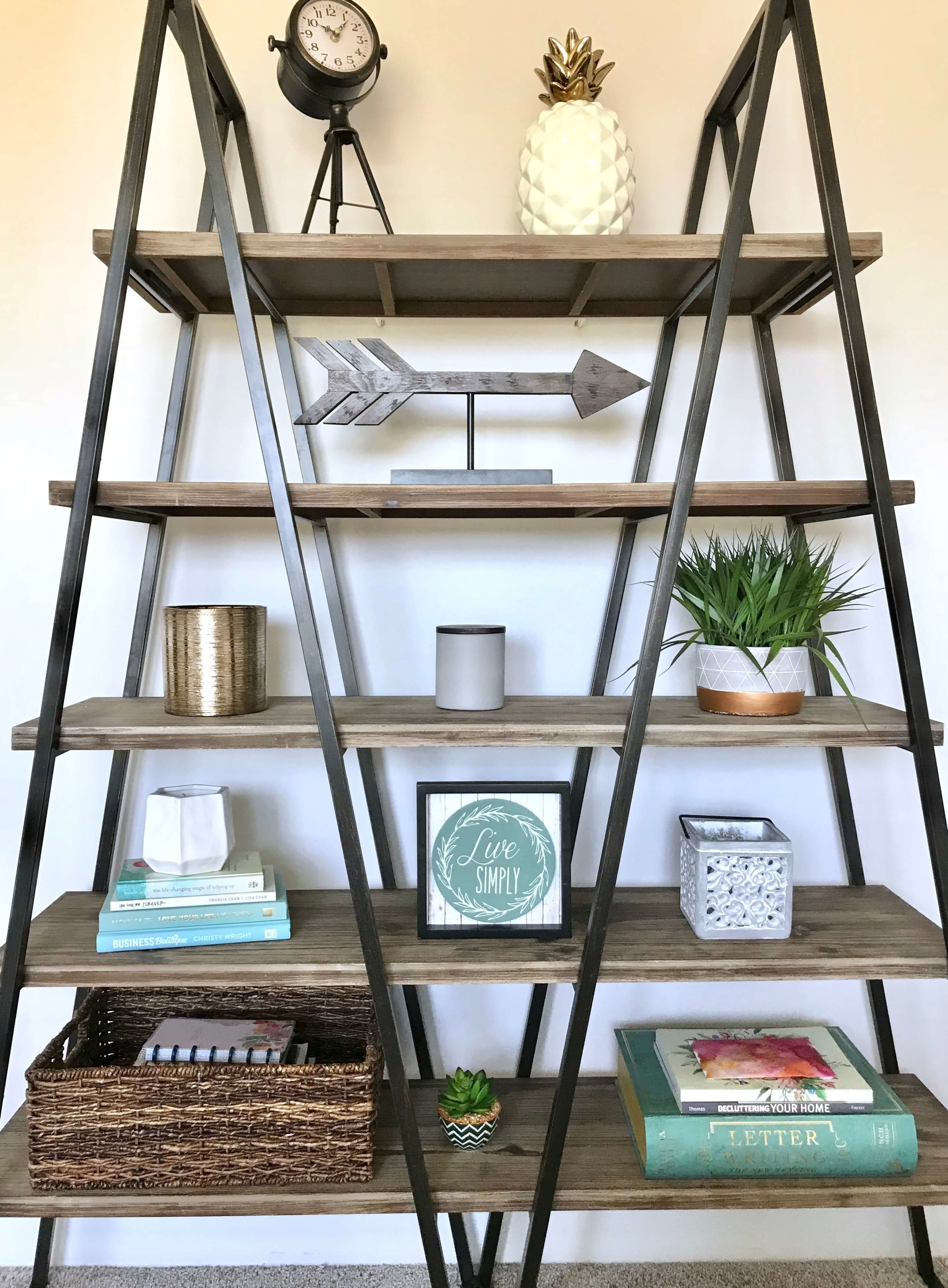 A balanced bookshelf is all about textures and interest.