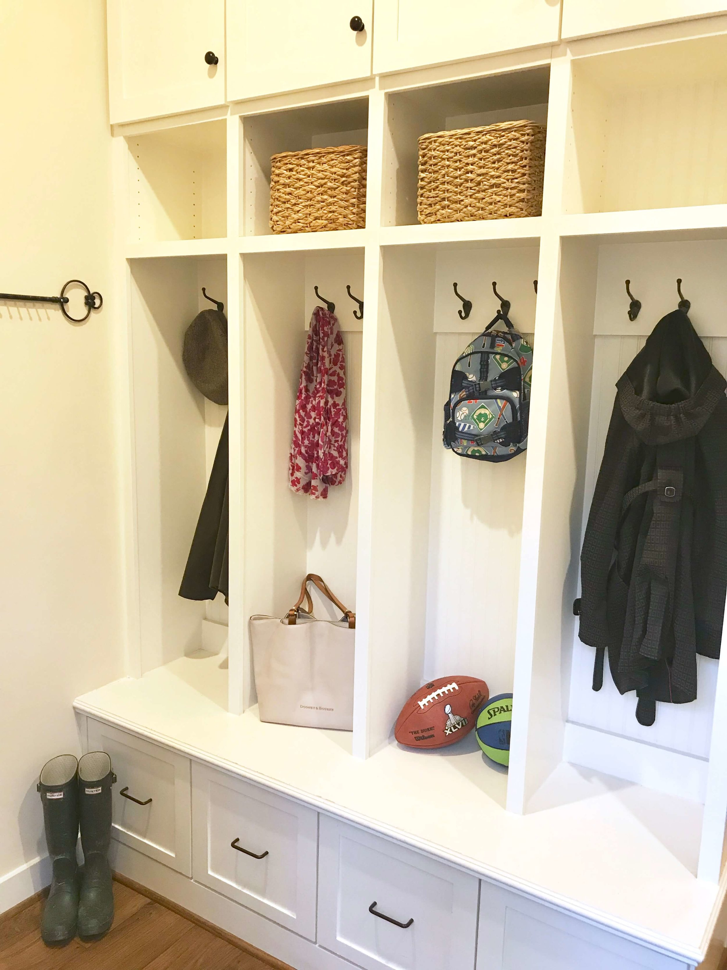 A mudroom drop-off area should simple, yet functional.