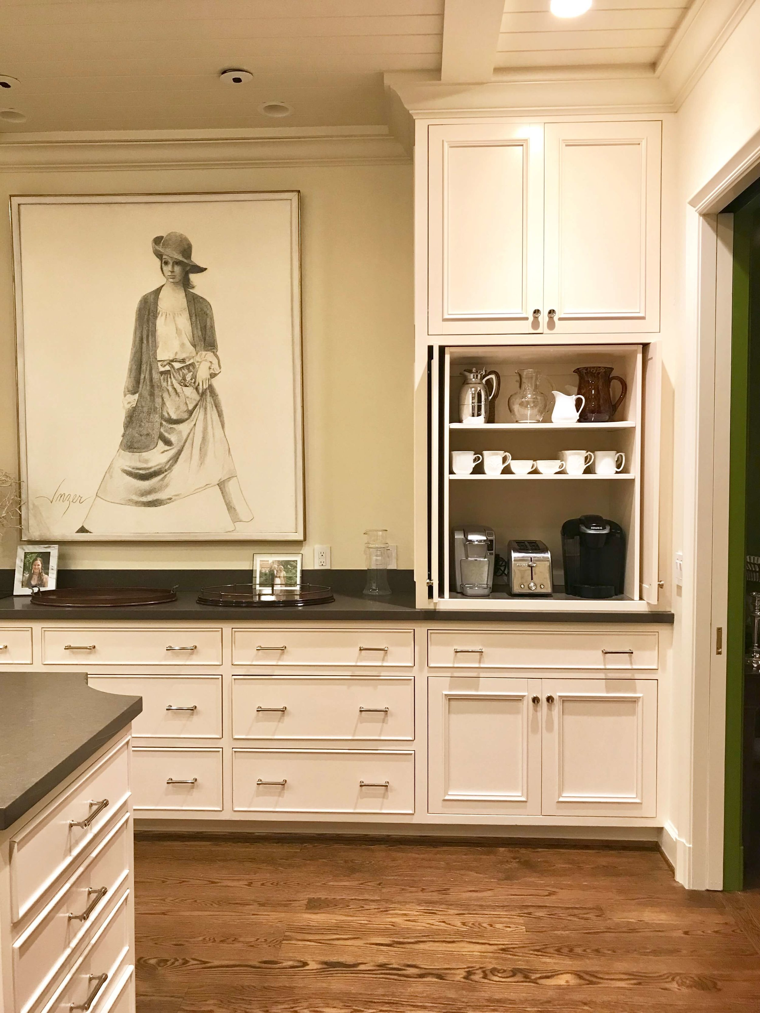 A staged kitchen and coffee station.