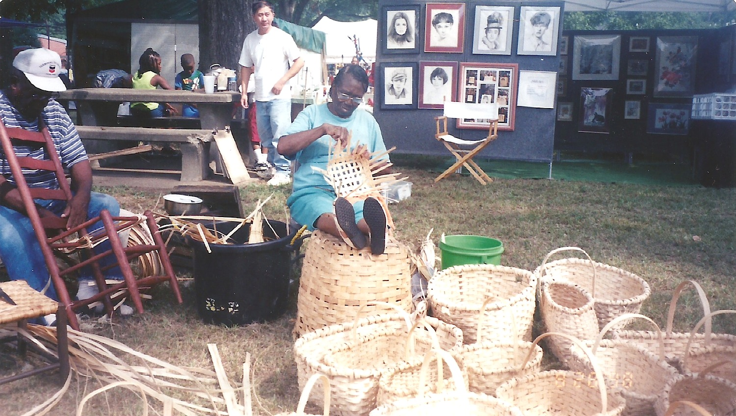 Estelle's parents, Sterling and Mary Ella giving a weaving demonstration in the early 1990s