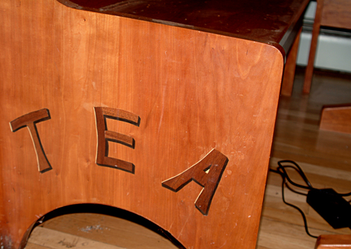 Solid cherry bench and table with the kids initials inlaid. Coincidence it spelled TEA! Tristan, Elizabeth and Andrew.