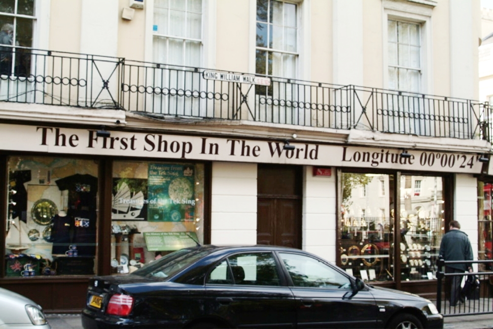 The First Shop in the World is so called because it is only Zero degrees, zero minutes, and just 24 seconds from the Zero Degree Meridian line. This line, of course, is in Greenwich. Thus Greenwich Mean Time.
