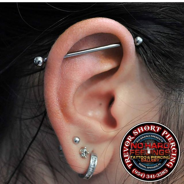 Industrial done by @trevorshortpiercing here at @nohardfeelingstattoo . . . . . #soflo #piercings #piercing #pierced #piercingaddict #piercingshop #bellybuttonring #modifications #bodymods #bodypiercing #bodypiercer #piercingsofinstagram #piercingstudio #alternative #nohardfeelingstattoo #worldfamous #tattooshop #southfloridatattoo #famous #coralsprings #nohardfeelingstattooshop #anatometal #neometal