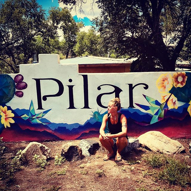 By the way, this is my little town: Pilar, New Mexico😍  Part Two of Jen's Story  As I stepped off the plane in Maui to begin to quest toward healing, I was vomiting green chunks into a small plastic bag. I was hungover. Deeply hungover from the night before where I celebrated my twenty-third birthday in an Irish pub. I was determined to start a new way of life. I hoped that Maui would cure me of my depression, my alcoholism and my addiction to men. It didn't cure me, but it was forward movement for sure.  I began to do yoga at 6:30 (in the morning by the way). I had never emerged from my bedroom before 11am. I began to eat fresh fish and lay in the sun. I began to plant eggplant and taro root in the earth. I learned about crystals and Taro cards. I saw naked people - naked people everywhere. This blew my boxed-in Christian mind. Never before had I ever seen sensuality celebrated so freely. I began to have conversations with Max (a Jewish mushroom enthusiast from upstate New York who also loved brewing up green juices) about God. We would squat side by side in the garden and talk about the meaning of life and Max, well he blew my mind. He introduced me to a God I never knew existed. He introduced me to the concept of the Divine and the chains of my evangelical Christian upbringing began to fall away. And then, I met this guy… *** #soulhealing  #renegadeastrologer  #astrologypost  #innerquest  #pilar  #newmexico  #desertdwellers