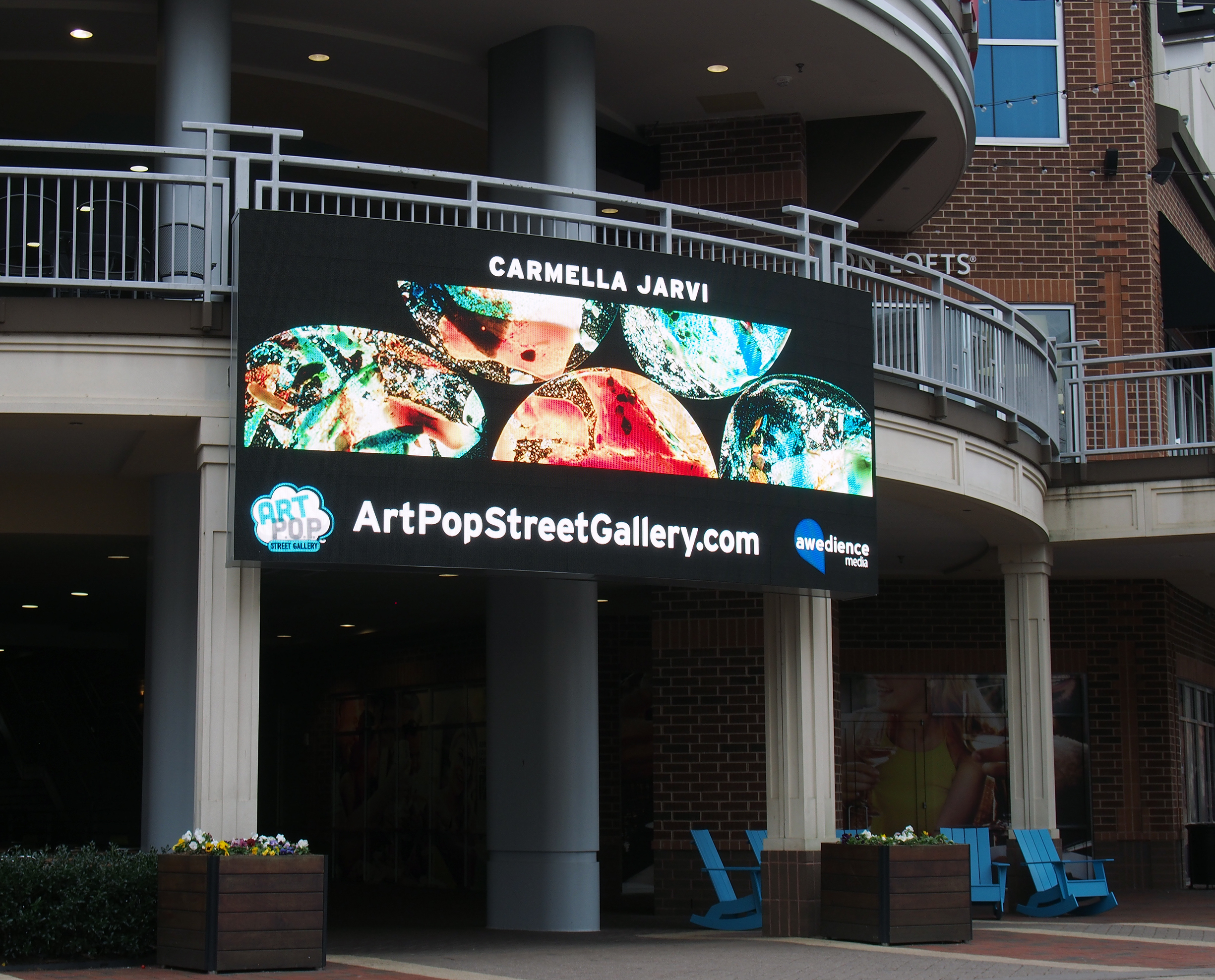 Jarvi's ArtPopCLT 2018 image on a large curved digital display at  Ballantyne Village  - thanks to  Awedience Media :)