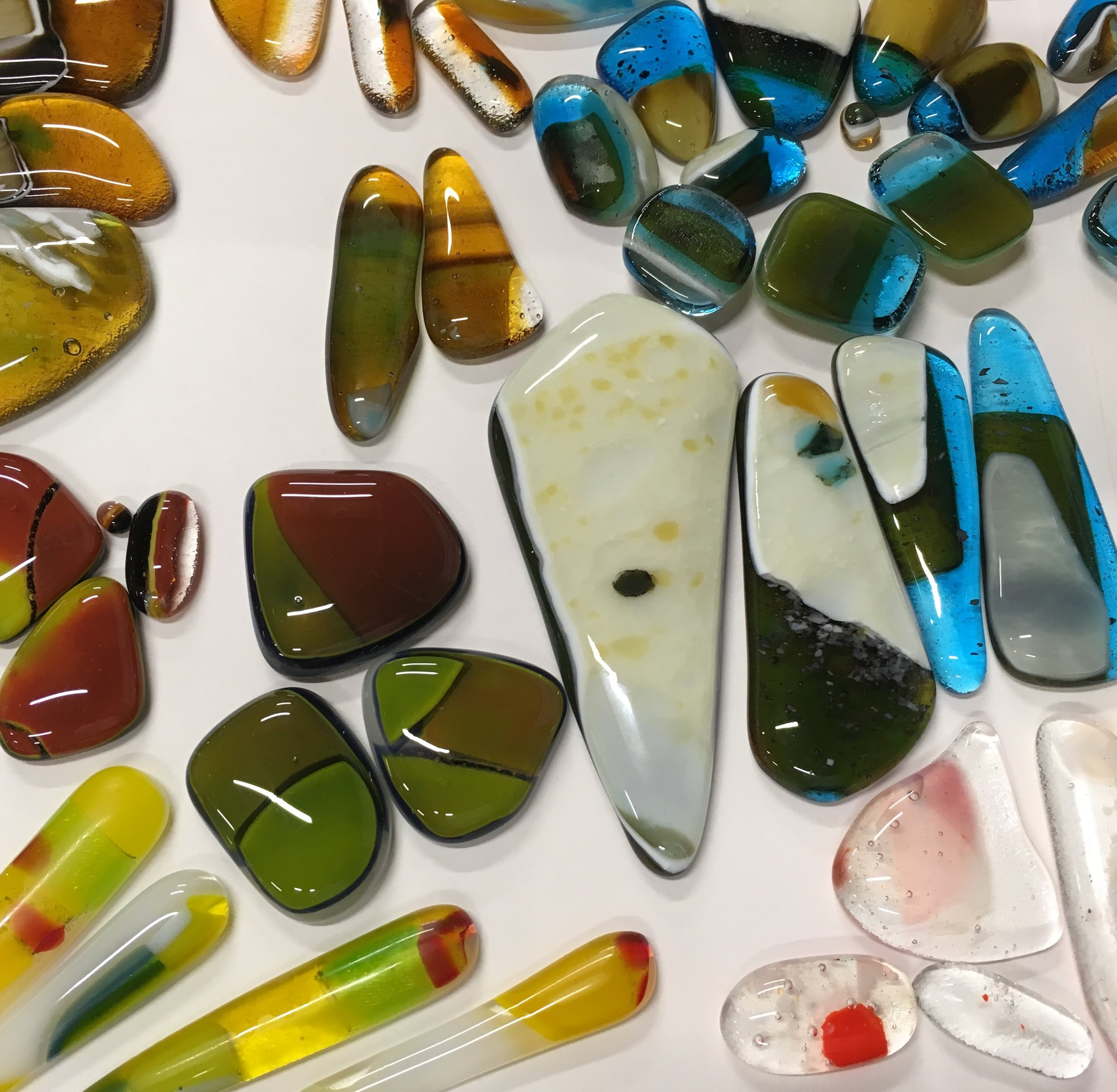 Above is a little teaser of working glass pieces - some will be transformed into single cabs or multiple glass compositions. The new glass jewelry line will start with  Statement Necklaces .