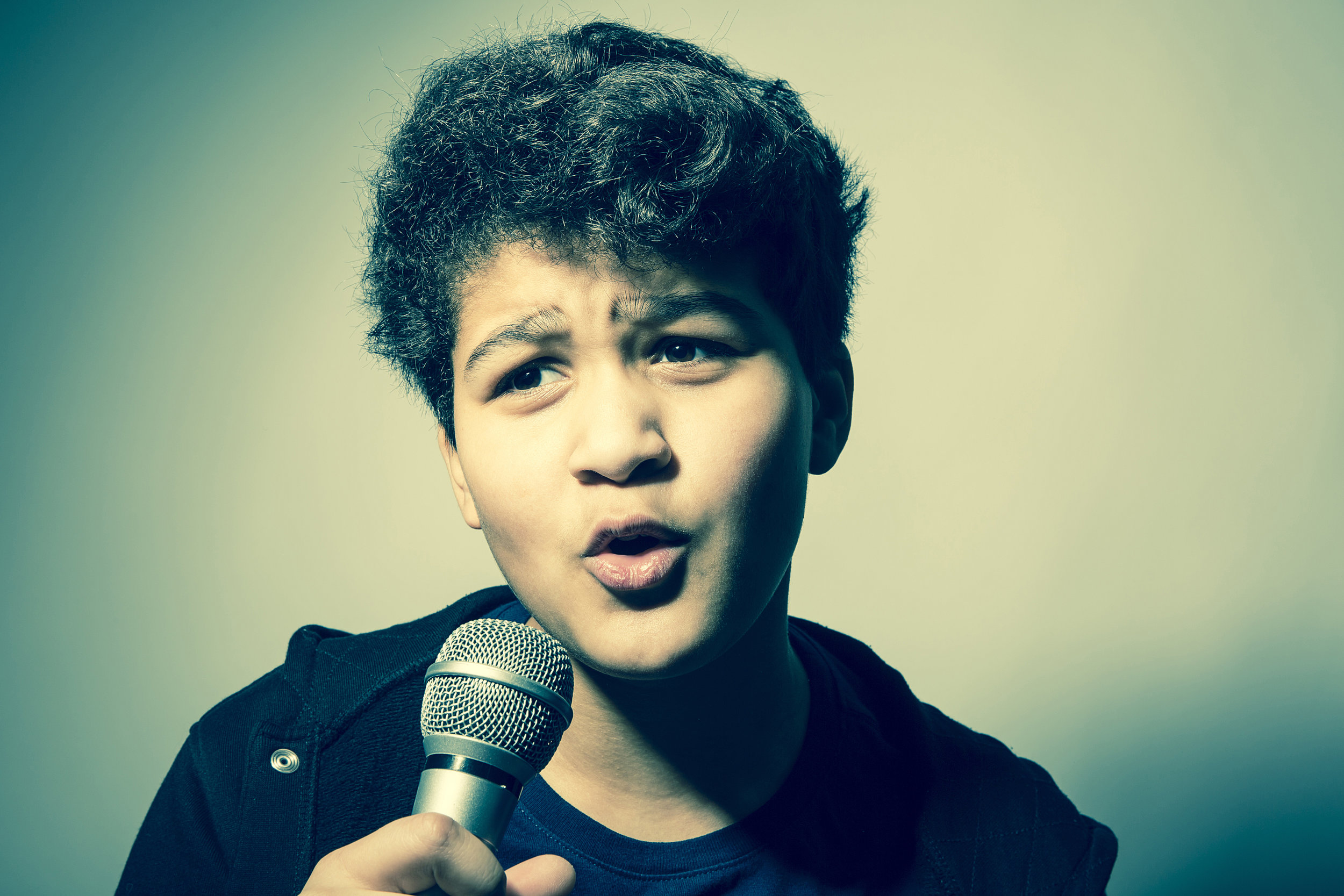 Boy singing.