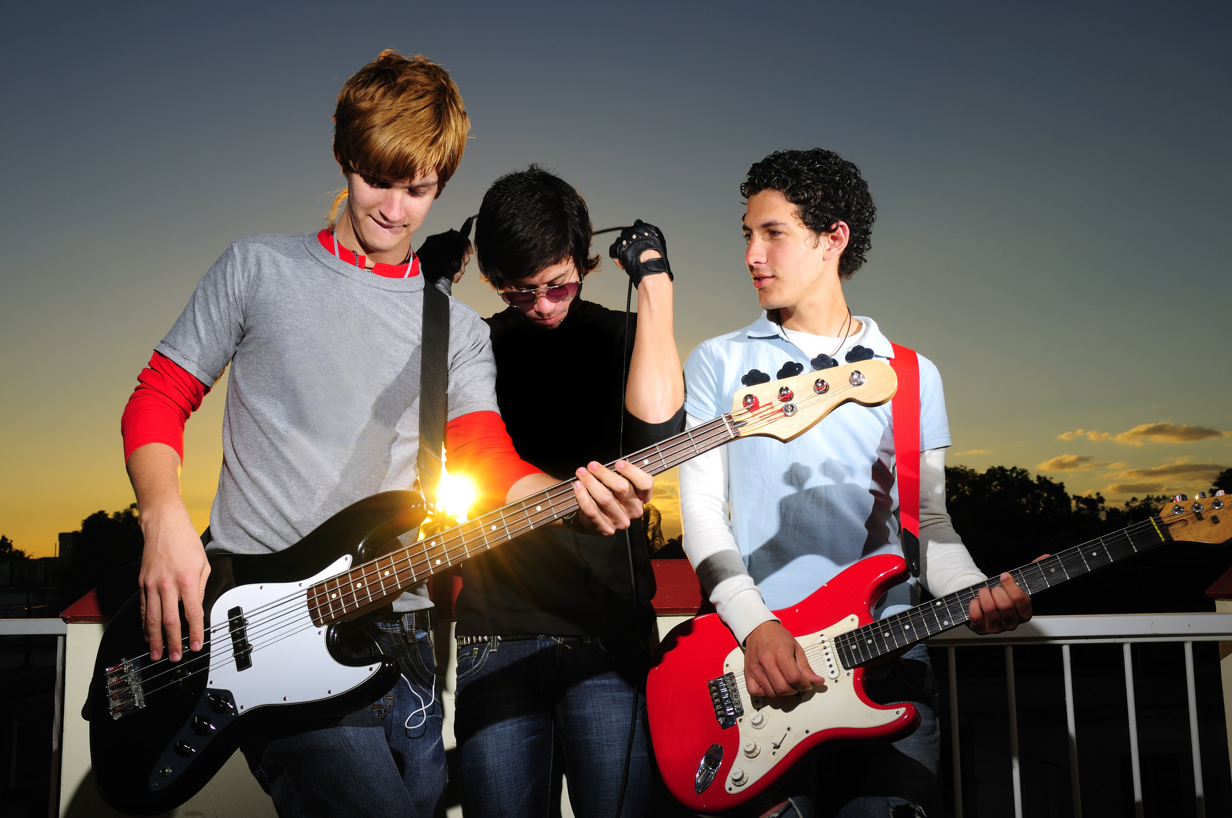 Young musicians posing with instruments