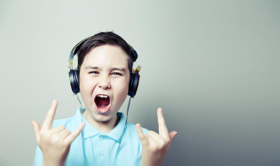 cute boy listening to music