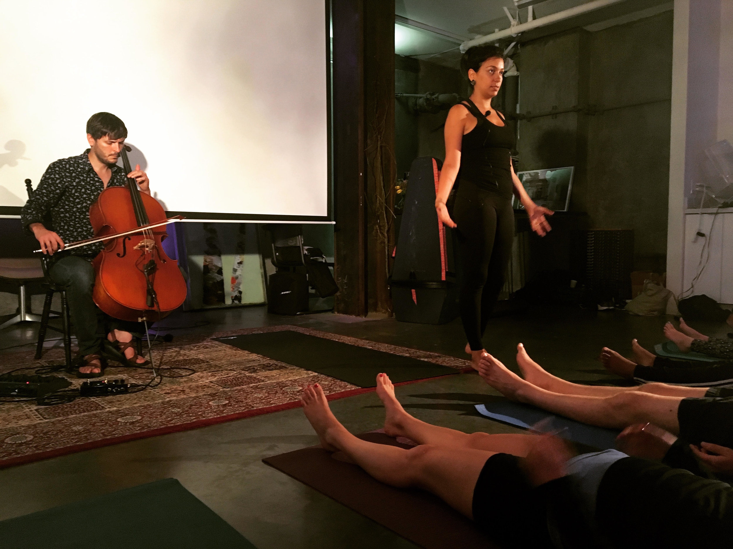 Maayan Ivgi of  Mayan Body and Soul  leads a yoga class to the cello music of  Joshua McClain