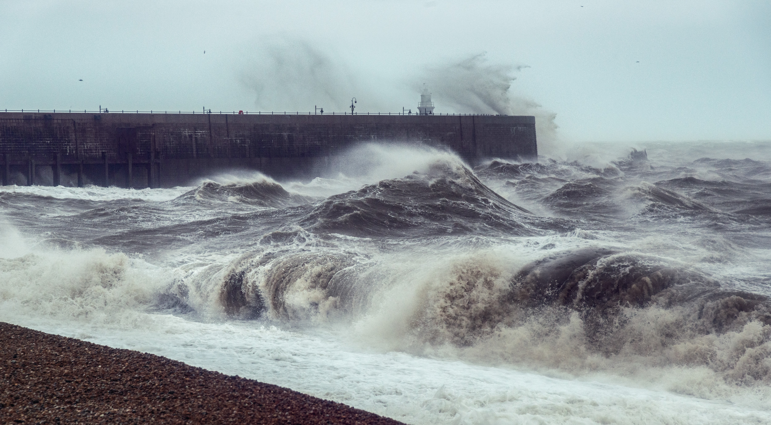 Massive waves crash over the Harbour Arm at Folkestone