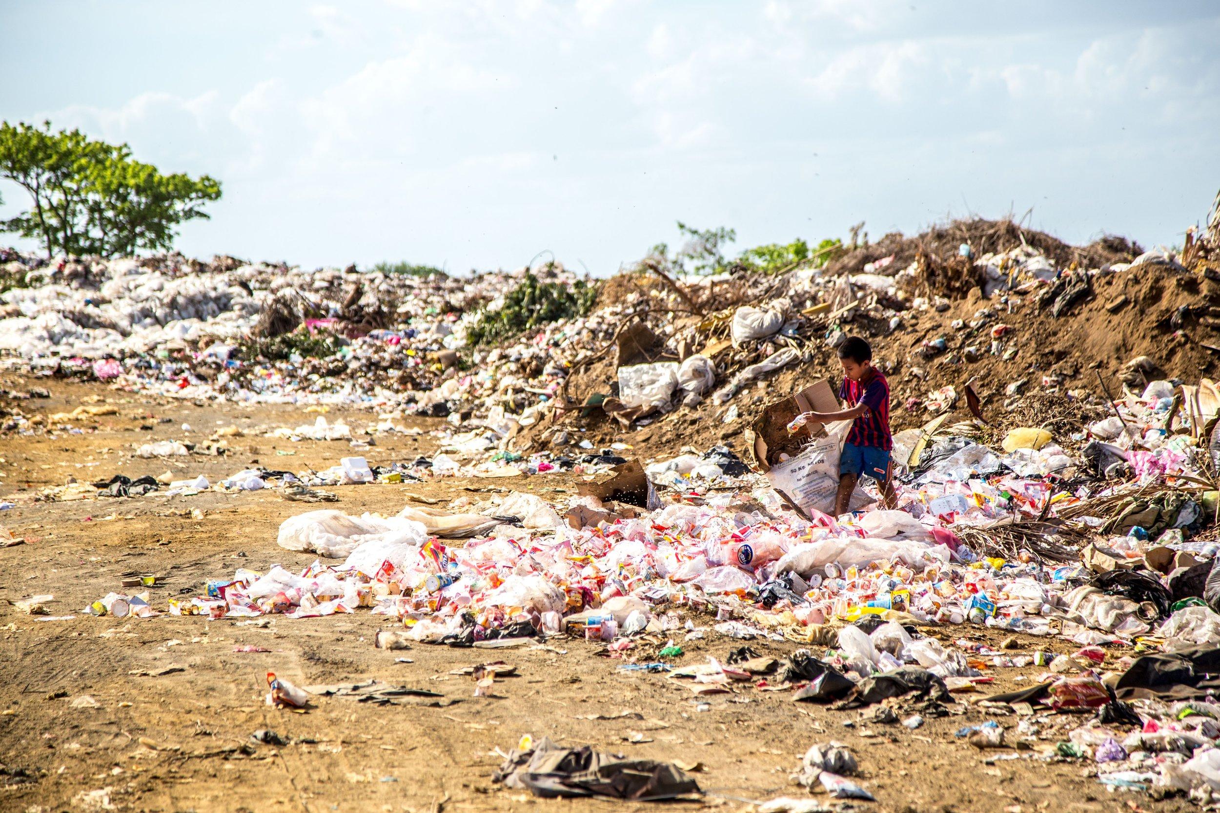 A child picks through a landfill in Brazil.
