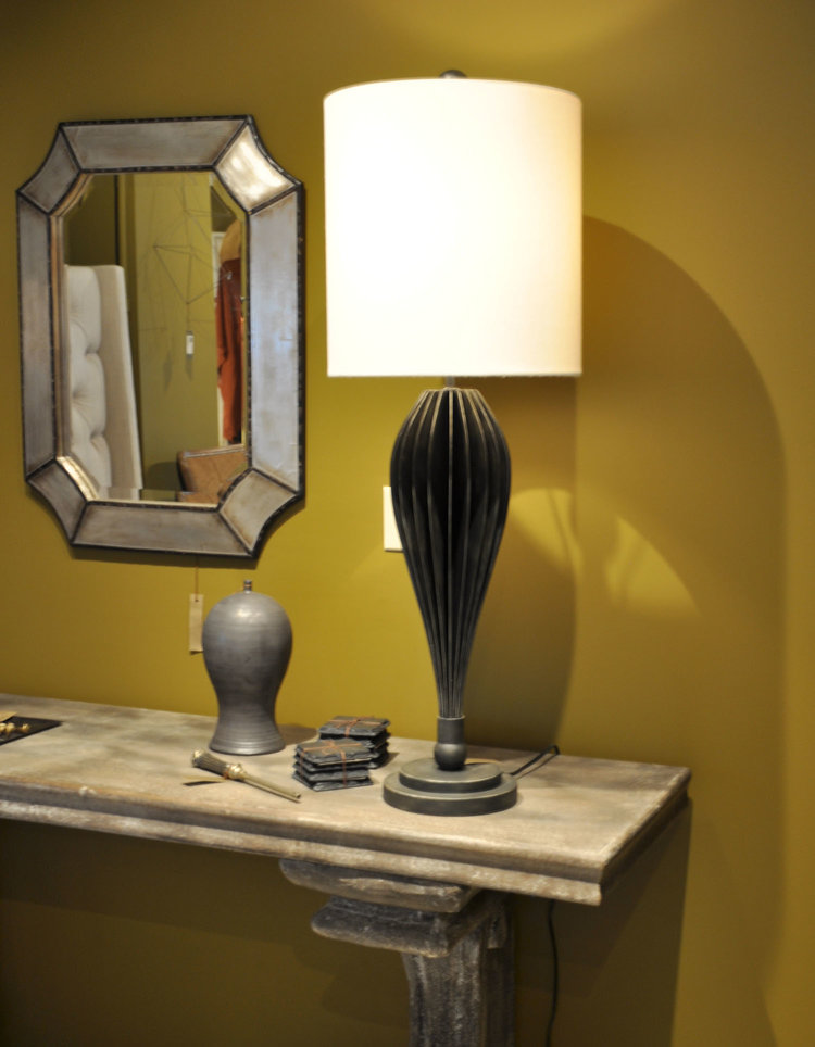 Salerno Table Lamp  $650 Steel Fins with Black Finish   Agora Console  $985 Fiberglass & Faux Concrete Finish   Matt Black Ginger Jar Bottle  $100   Barcelona Antique Bronze Lighter  $45   Phuket Collection Venoy Mirror  $275 Hangs Vertical or Horizontal Wood and Metal Beveled Glass   Slate Coasters/Candle Trays  $22 Set of Four