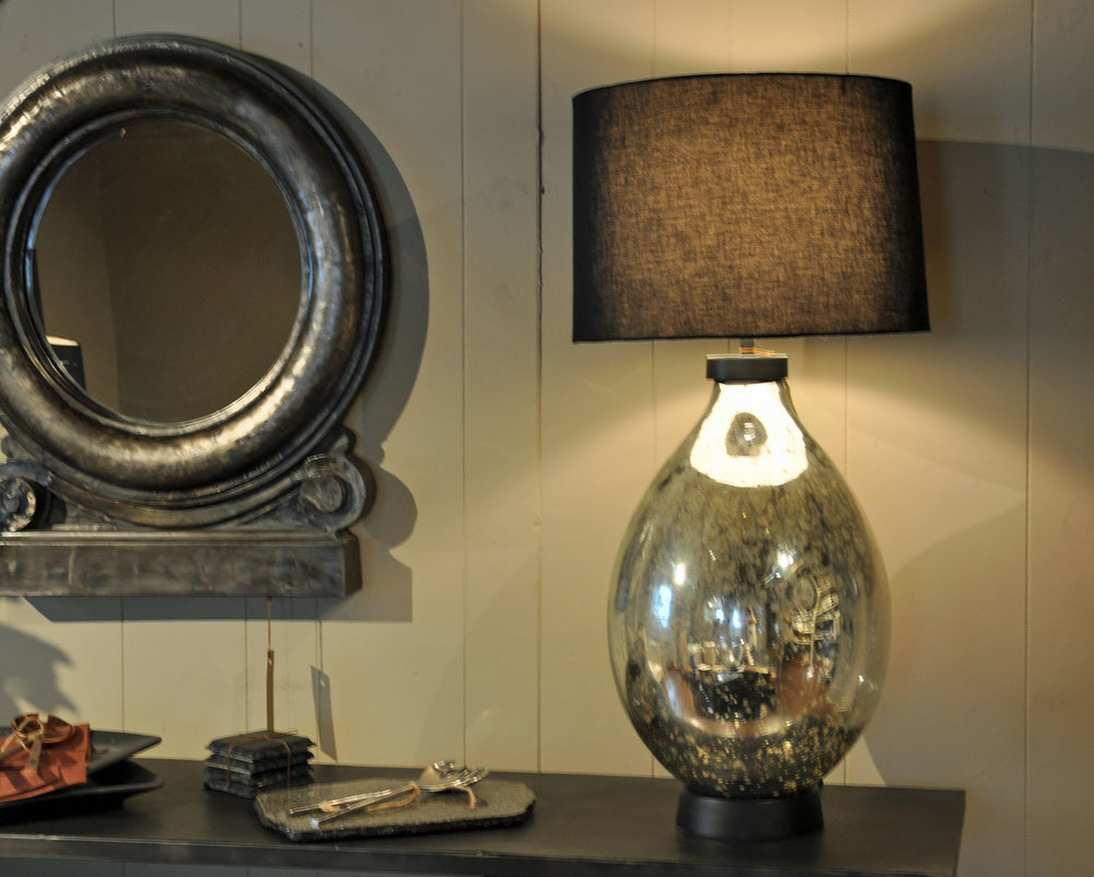Liezen Collection Lamp  $275 Silver/Mercury   Slate Coasters/Candle Trays  $22 Set of Four   Vaskapu Collection Iron Medallion Mirror  $425 Made in India
