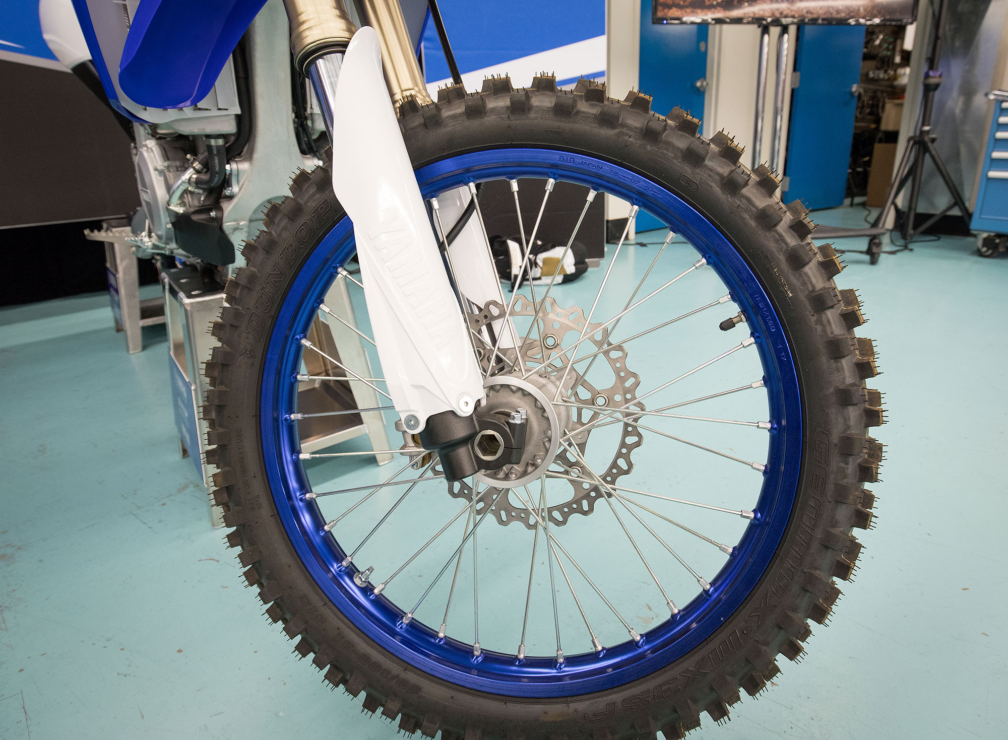 The blue wheels have more of a flat look to them than a glossy blue color.