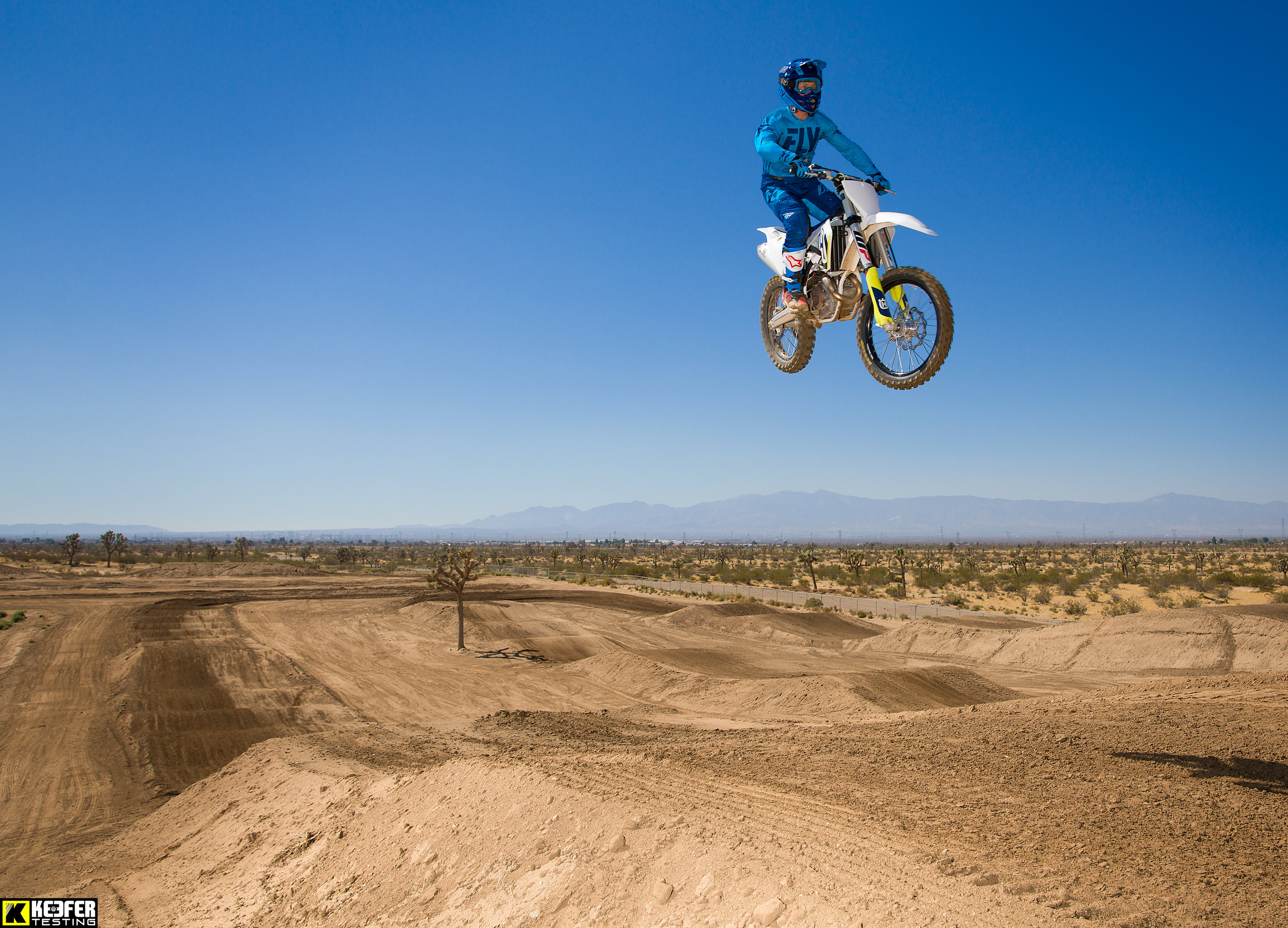 Broc Shoemaker flies the Husqvarna through the clear skies of the high desert.