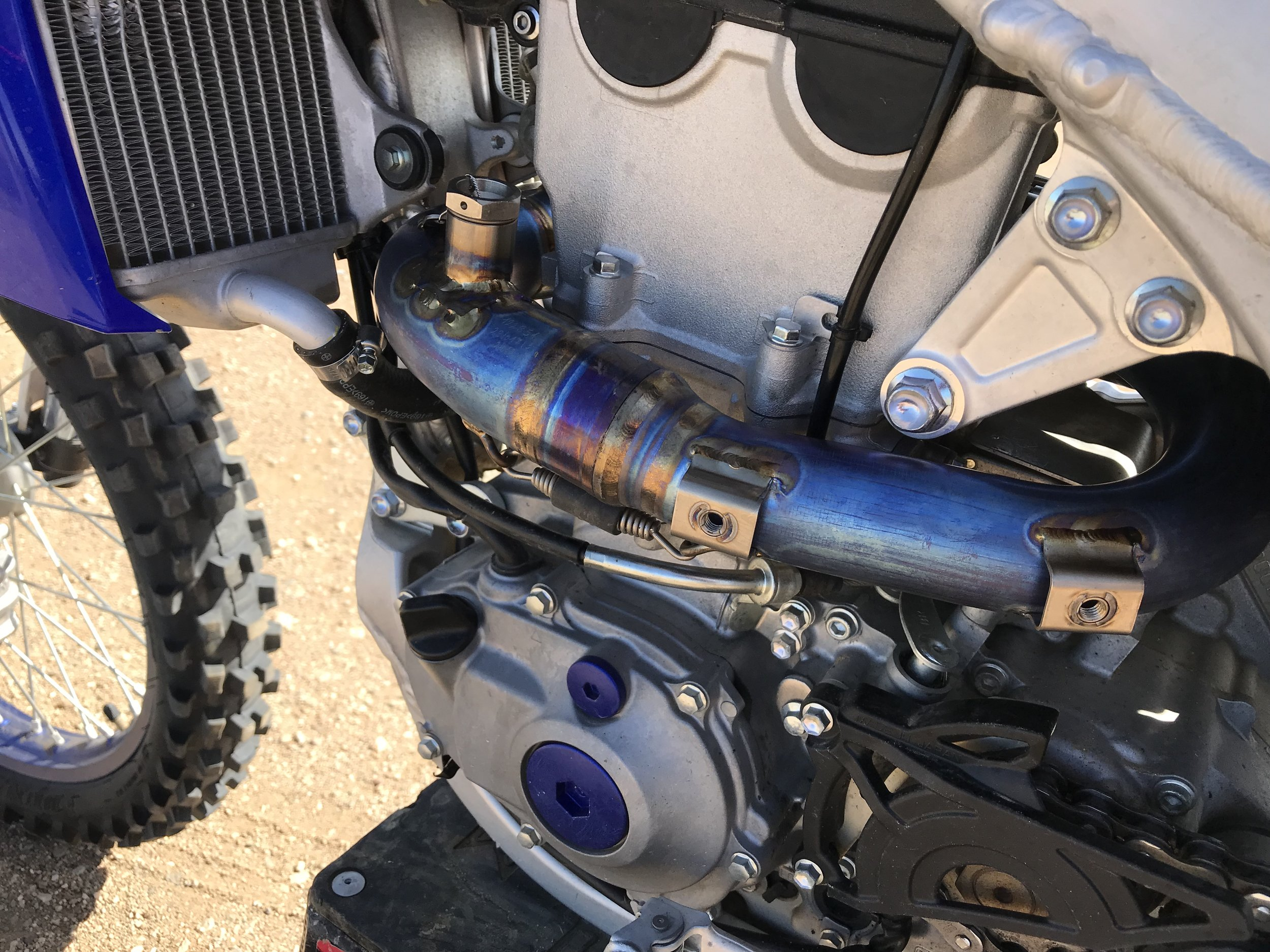 The Akrapovic accepts the use of Yamaha's stock heat shields.
