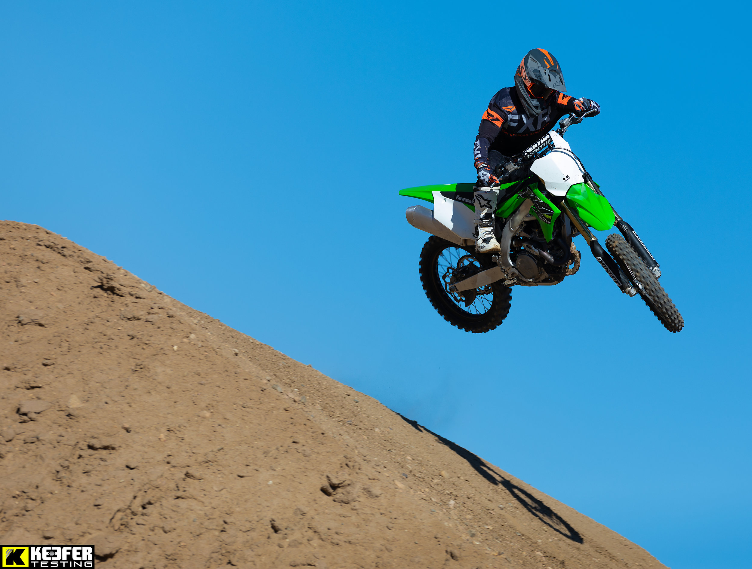 """The most improved machine in the 2019 450 MX Shootout belongs to Team Green. The KX450 won the first day of the shootout and was a favorite of most testers throughout the week. The chassis is well behaved and can be pushed hard by the rider without it doing anything out of the ordinary. The lightweight feeling of the KX450 is noticed immediately around the track and the free-feeling engine character makes it a very fun/playful bike to ride. With four """"individual test rider opinion wins"""" it was the only other bike in the shootout to keep the Yamaha honest. Kudos to Kawasaki for making a great first year/generation KX450. That is not easy to do!"""