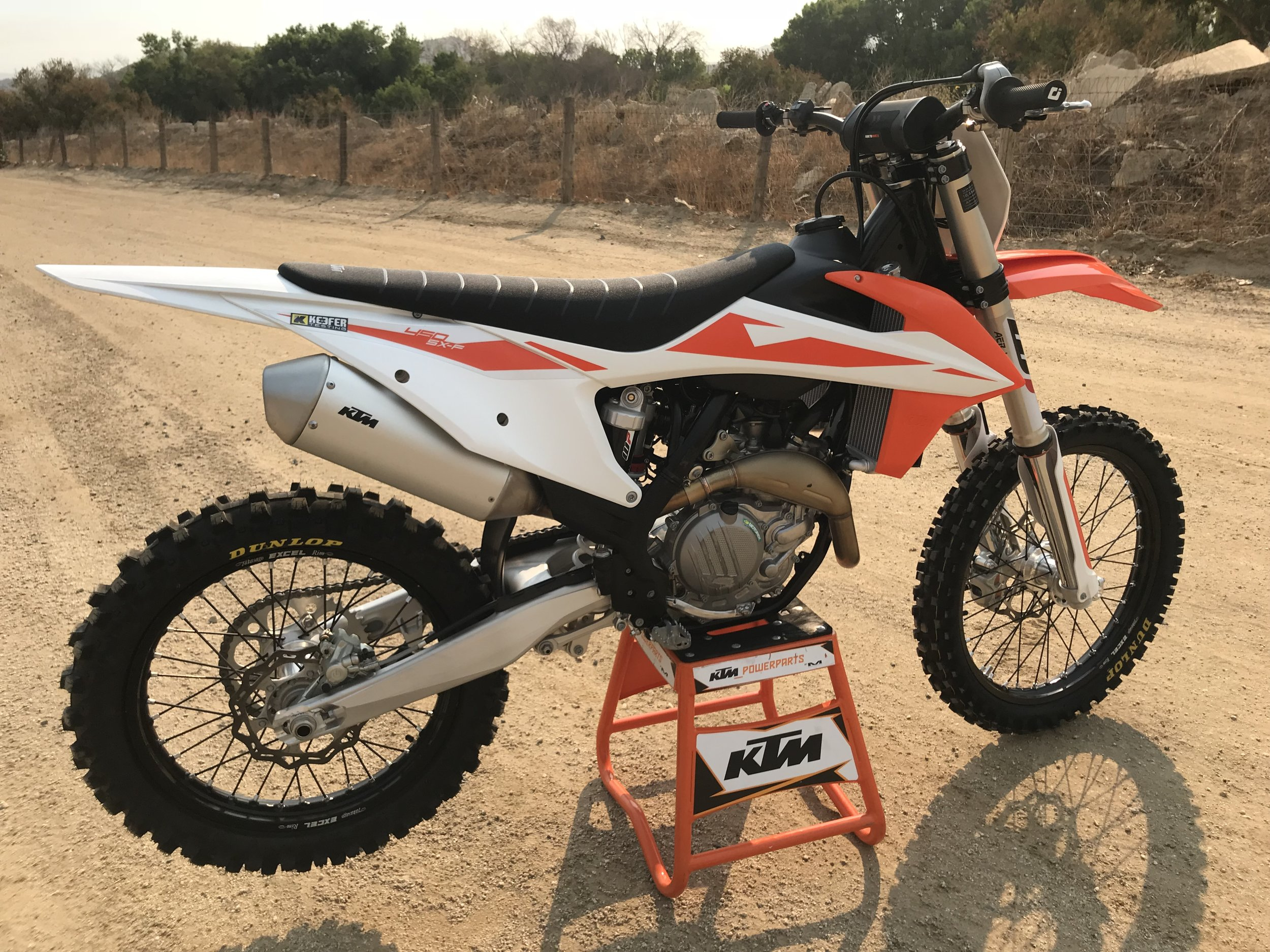 The KTM 450SX-F has more bottom end and RPM response than the Husqvarna, but lacked some compliance/comfort when the track got choppy and rough. The KTM still feels lightweight through corners and gives riders, that lack cornering technique, more confidence through ruts. The Neken handlebar is a little more rigid than that of the Pro Taper bar that is on the Husqvarna and that doesn't help on slap down landings. The engine character is smooth and linear thus helping/forcing riders carry more speed through corners. The WP/AER front fork lacks some small bump absorption, but once you break through that initial part of the travel, it is quite nice. The KTM 450 SX-F is one of my favorite bikes to ride with some minimal modifications done to it. The is how close all of these bikes really are! A little massaging here and there can make a fourth place bike a first place machine.