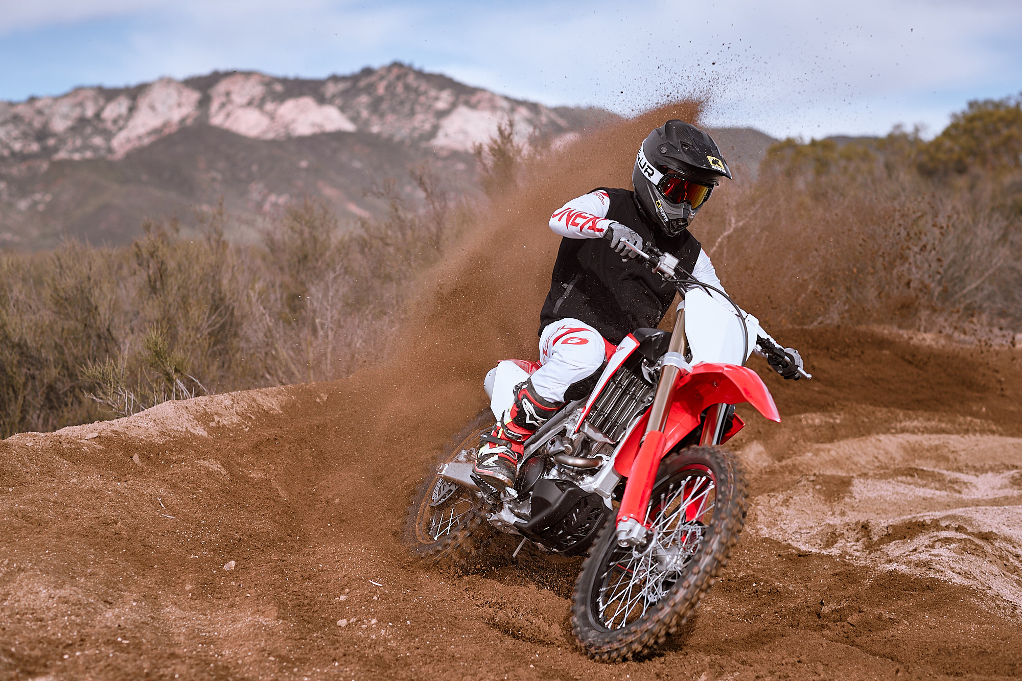 The Honda loves to carve up some berms.