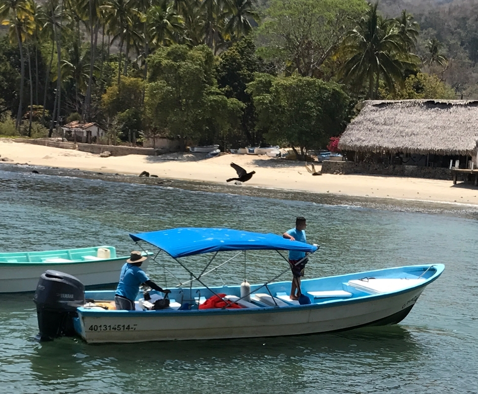 The Xinalani boat that will bring you to the beach, or the pier by town (10 minute walk to resort).