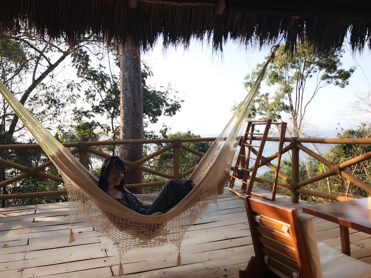 Colleen lounging on the hammock in our Small Palapa's terrace.