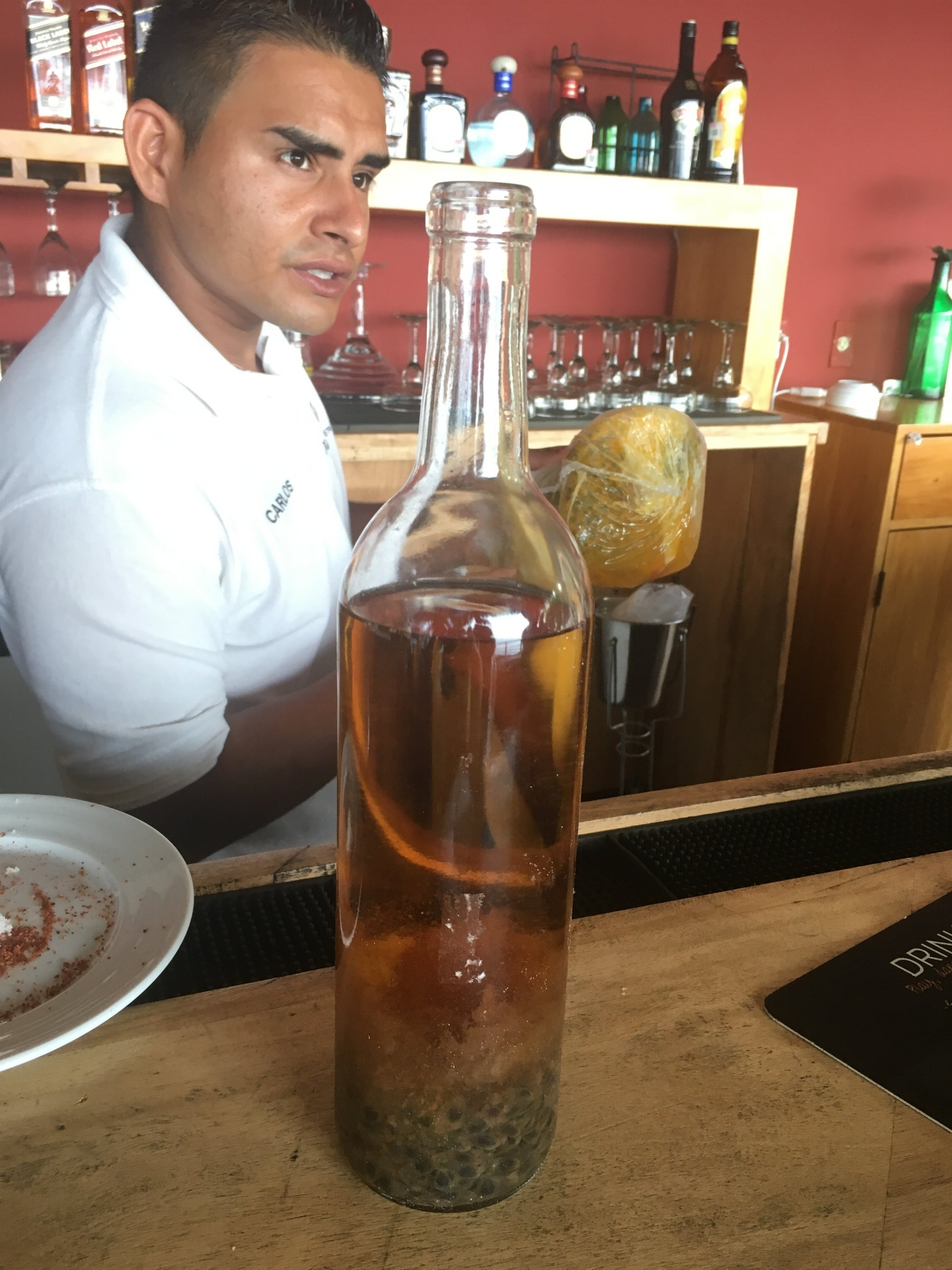 Carlos explaining what's in the strongest tequila in the world in the bottle pictured