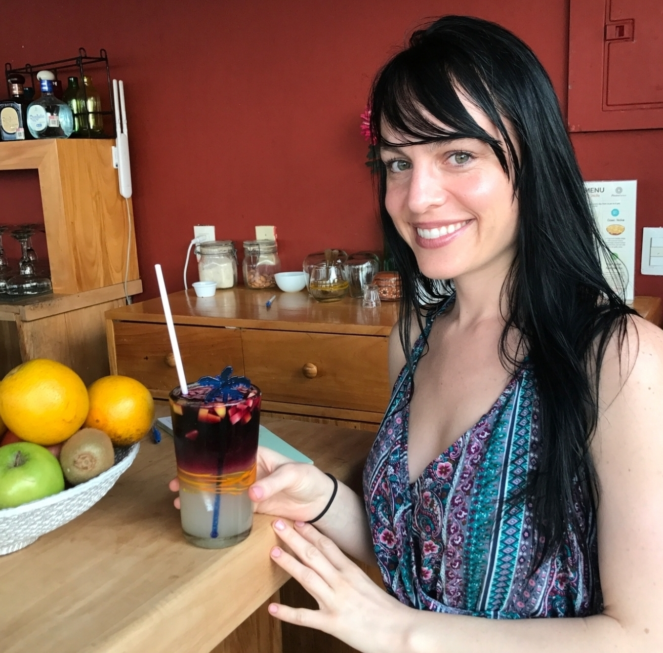 Colleen enjoying their delicious red sangria with fresh fruit and herbs.