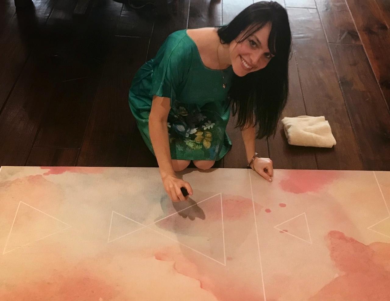 Spraying the mat thoroughly