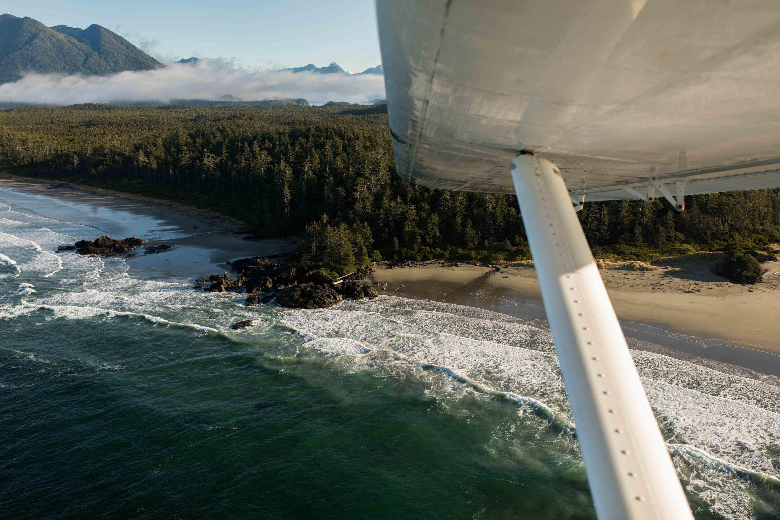 Cessna airplane flying over the coast