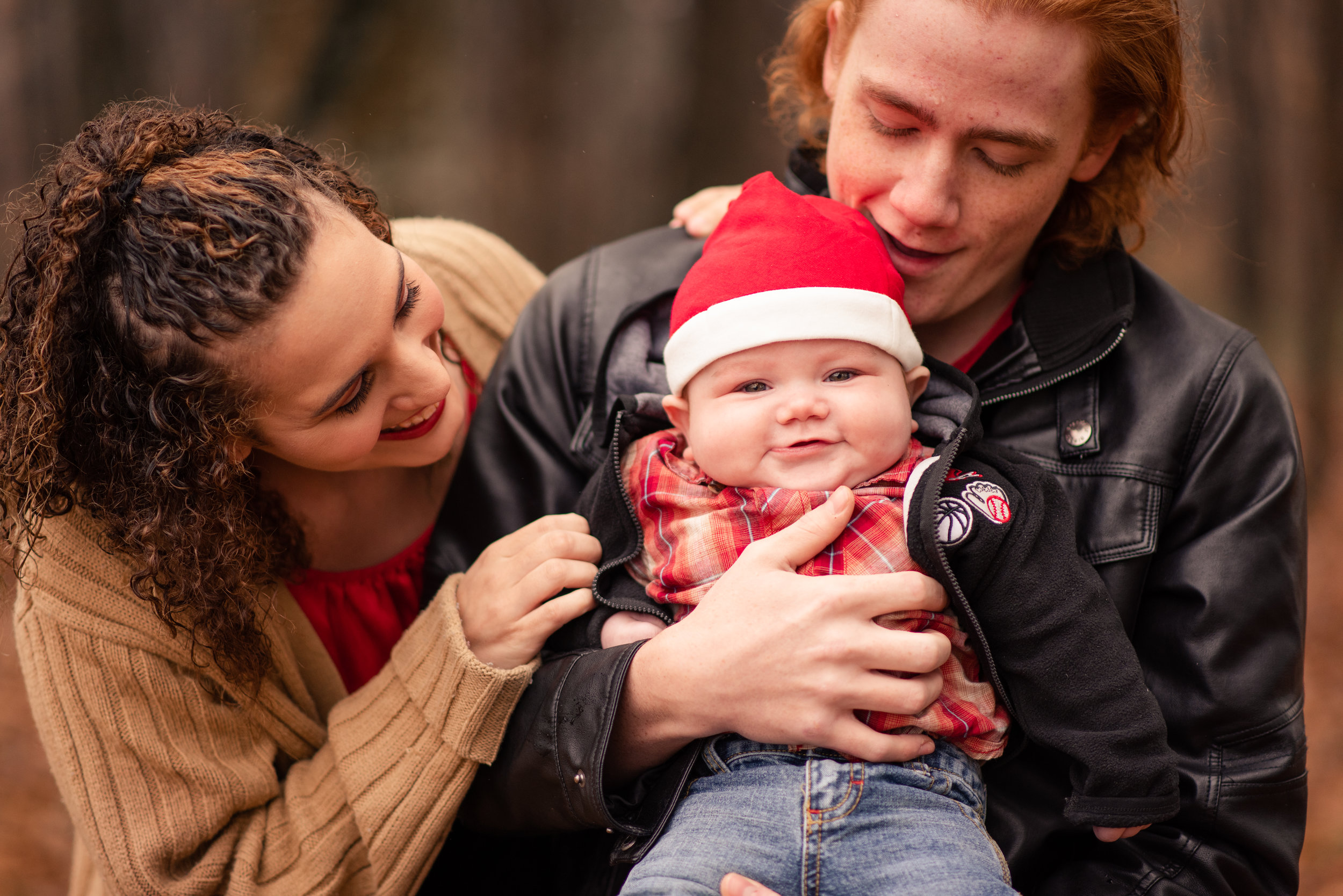 Leon at six months old during Christmas 2018 with his adoring mama and dada, Mariah and Nate! I'll never forget this shoot!